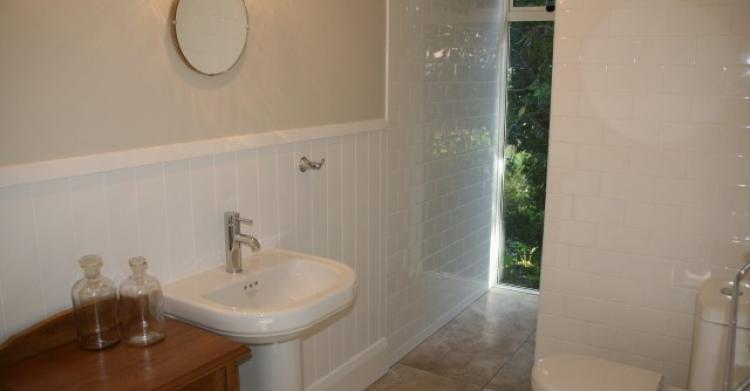 Tiled ensuite bathroom with character fittings