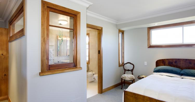 Master bedroom with recyled feature windows